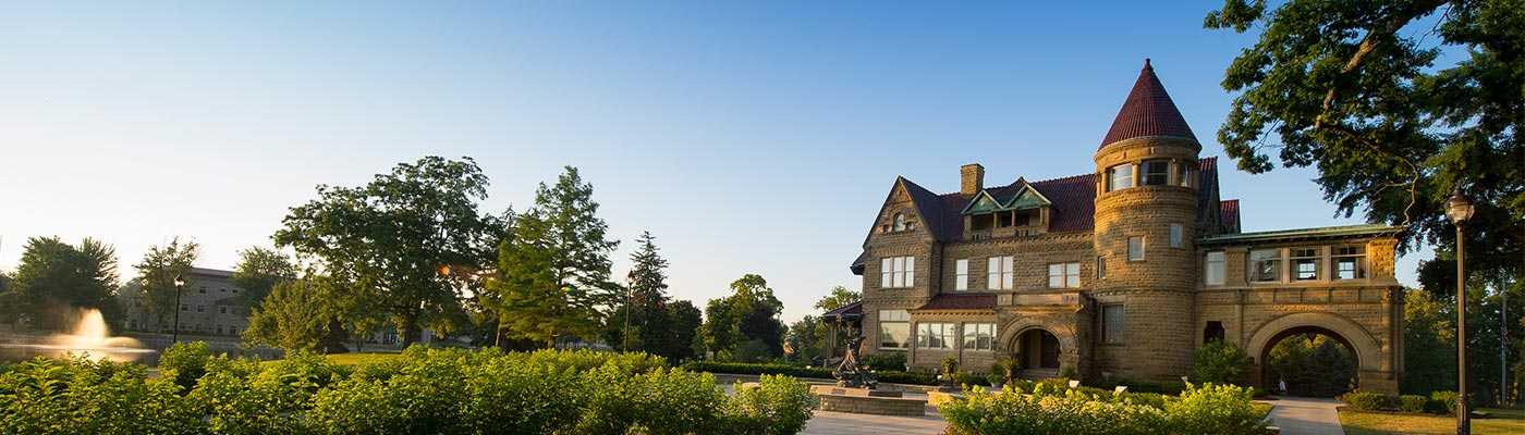 Front of Brookside Mansion during sunrise.